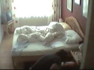 Pantieless girl masturbating pussy slit on the bed