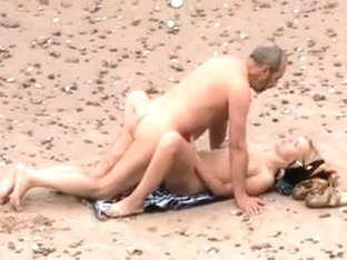 Mature couple makes love on the beach and get recorded by voyeur