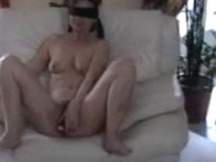 Blindfolded amateur MILF sucks hard dick with a dildo in her twat