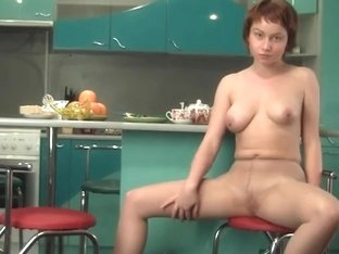 Redhead with big tits in nylons shows off in HD video