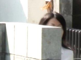 Asian school girl exposed during a skirt sharking.