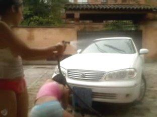 Latin Teens Wash a Car