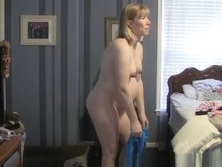 Pregnant woman changing clothes in bedroom