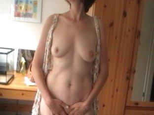 Mature broad enjoys dildo in a voyeur masturbation video