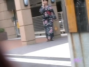 Black-haired small geisha flashes her tits when someone pulls her outfit
