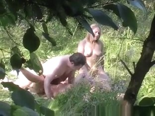 Two couples caught practicing swing outdoors