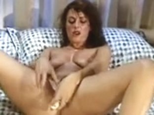 Older Dark Brown Touches Herself And Copulates With A Sex-Toy