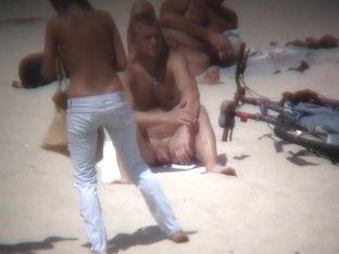 Nudist beach gets spied on by a professional voyeur
