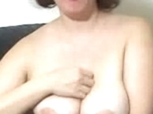 Busty MILF talks about masturbation on webcam
