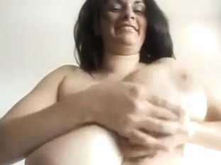 Beautiful milf wife jiggles her huge natural tits on cam