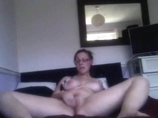 Chubby nerdy glassed ponytailed girl plays with herself on her bed