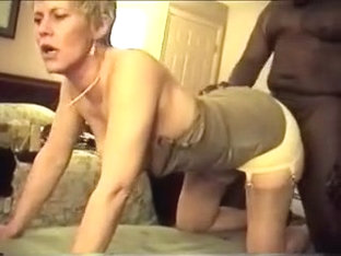Aged golden-haired sucks and bonks her darksome paramour at home in her bedroom
