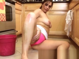 Mature 46-year old Milf Alesia Pleasure cleans up the floor