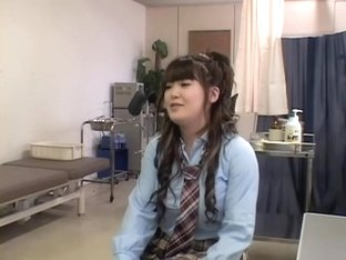 Asian teen enjoys some drilling during medical exam