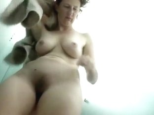 Pale mature woman in the pool's cabin