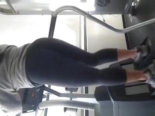 Sporty girl in tight black sports pants