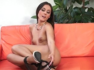 Iwia's sighs of delight fill the room as she fucks herself with a toy
