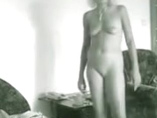 Girl posing naked in her bedroom and getting spied