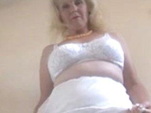 Aged lady in white underware
