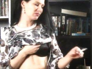 Brunette slut smoking and posing nude