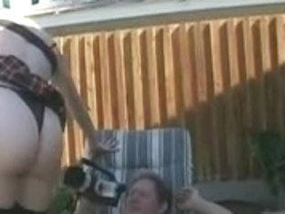 Blond tramp takes pecker in backyard with pants on in miniskirt