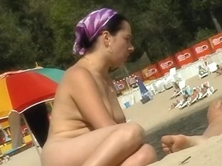Blonde has some good time on a nudist beach here