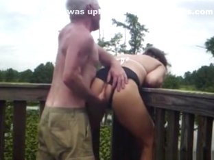 Crazy mature couple has sex on a bridge in nature
