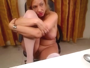 Curvaceous golden-haired momy fingers her soaked trench on cam