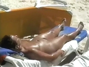 Spying on sextractive black brown honey on the summer beach