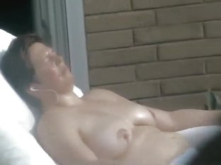 Mature neighbor woman caught tanning