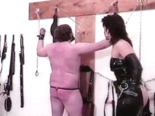 Saucy dominatrix uses her whip to make her slave's butt all red