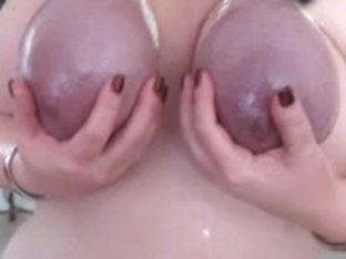 Kitten loves to hang from her tits and play with them!