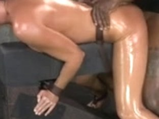 Milf shackled down and fucked raw by two cocks at once