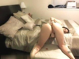 Solo brunette revealing her holes