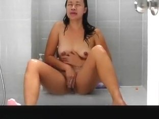 Oriental wife taking a shower