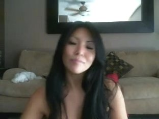 Sexy Asian chick plays with toys